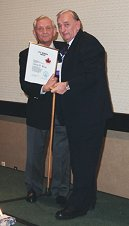 Lud Strah (right) accepting CMP Life Member Award from Klaus Konigsmann